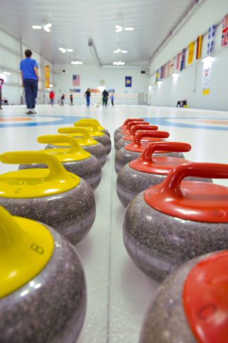 Curling stones lined up before a match