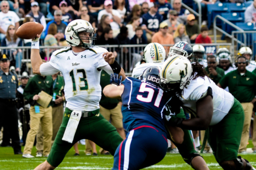 USF quarterback throwing a pass